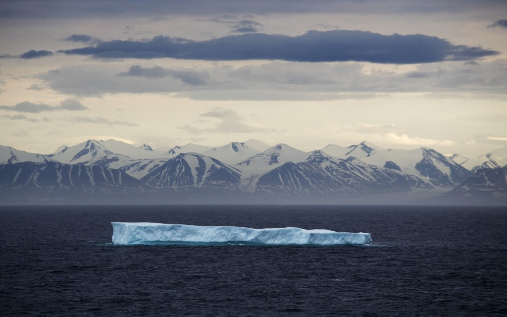 FILE - In this July 24, 2017, file photo, an iceberg floats past Bylot Island in the Canadian Arctic Archipelago. In a year of cataclysm, some world l...
