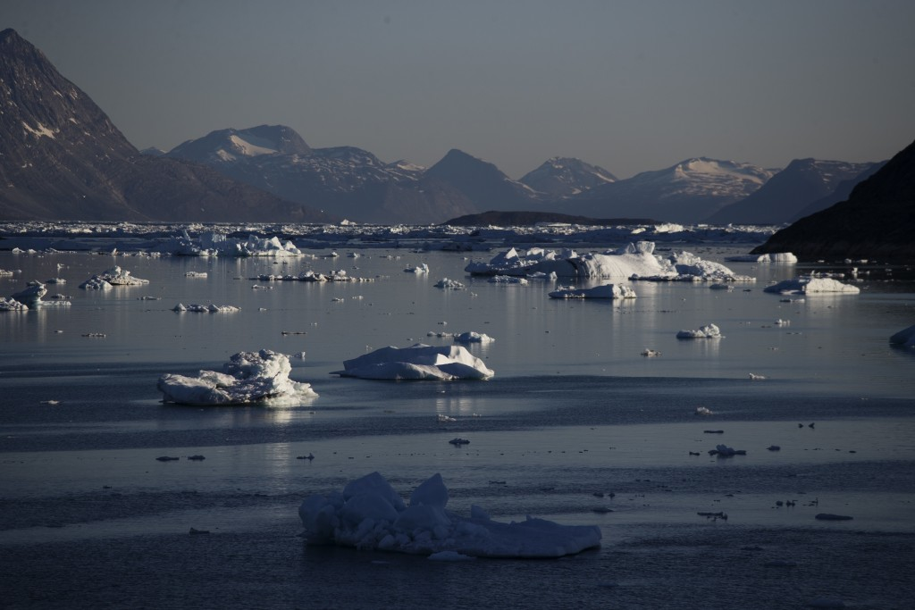 FILE - In this Tuesday, Aug. 1, 2017, file photo, icebergs float in the Nuup Kangerlua Fjord after breaking off a glacier on Greenland's ice sheet in ...