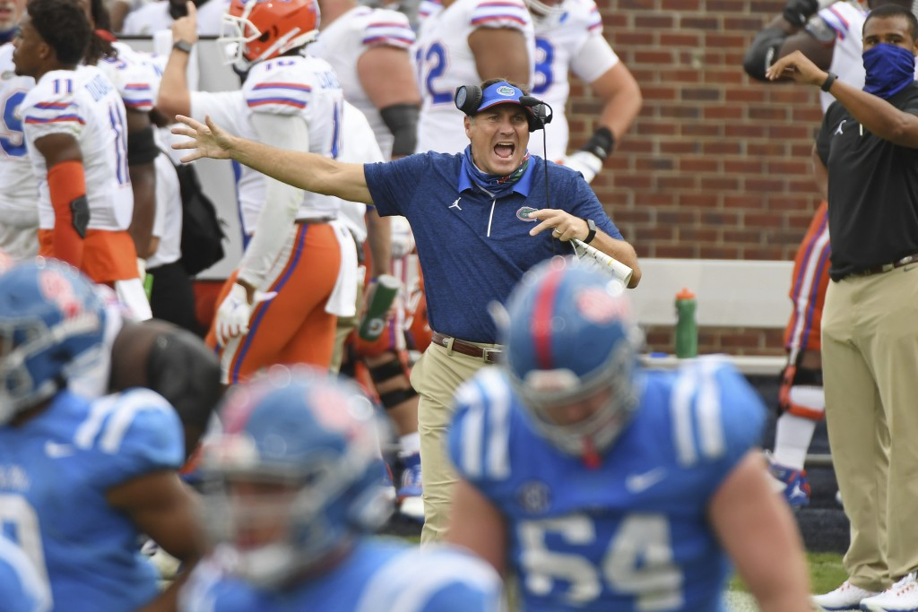 Florida head coach Dan Mullen reacts during the second half of an NCAA college football game against Mississippi in Oxford, Miss., Saturday, Sept. 26,...