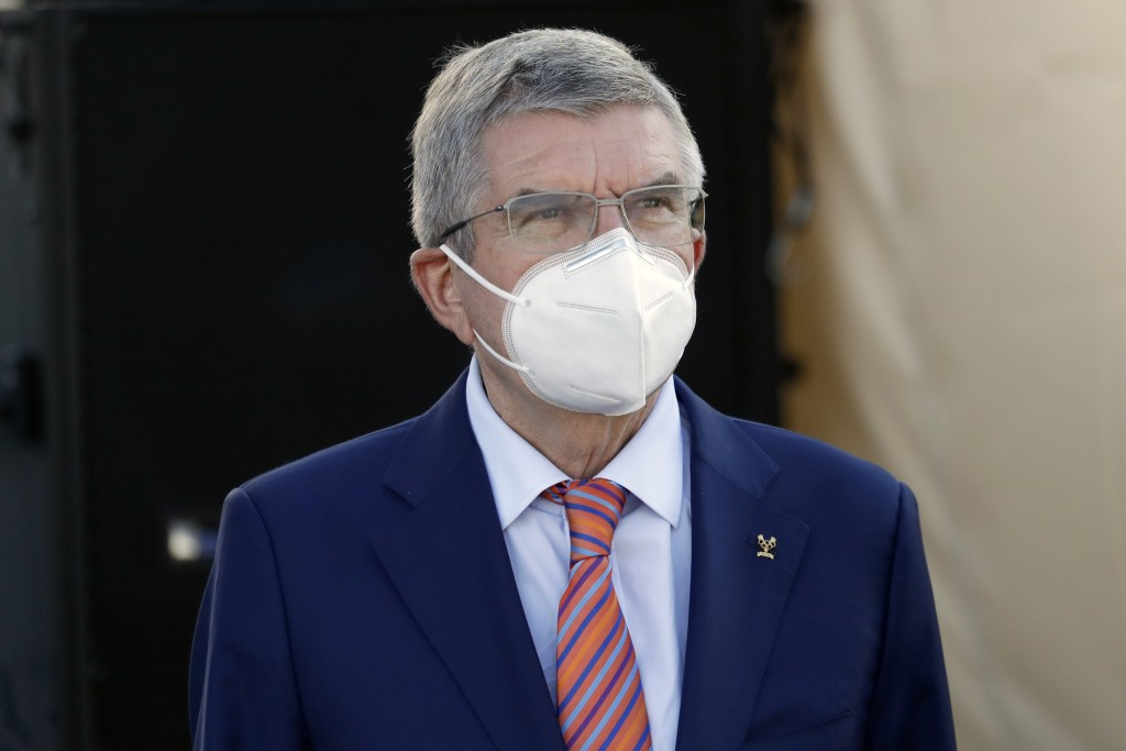 IOC President Thomas Bach waits for the podium ceremony for the women's elite event, at the road cycling World Championships, in Imola, Italy, Saturda...