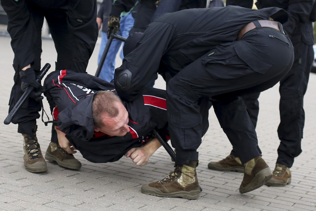 Police detain a demonstrator during an opposition rally to protest the official presidential election results in Minsk, Belarus, Sunday, Sept. 27, 202...