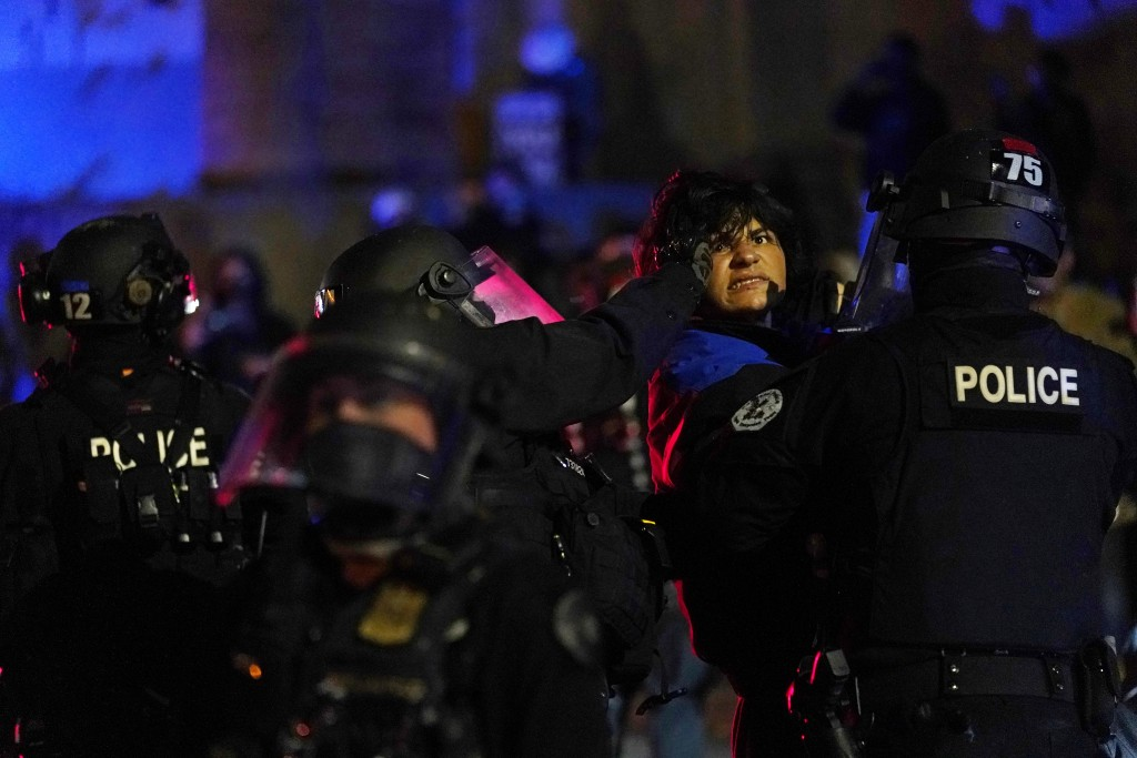 Portland police detain a man during protests, Saturday, Sept. 26, 2020, in Portland. The protests, which began over the killing of George Floyd, often...
