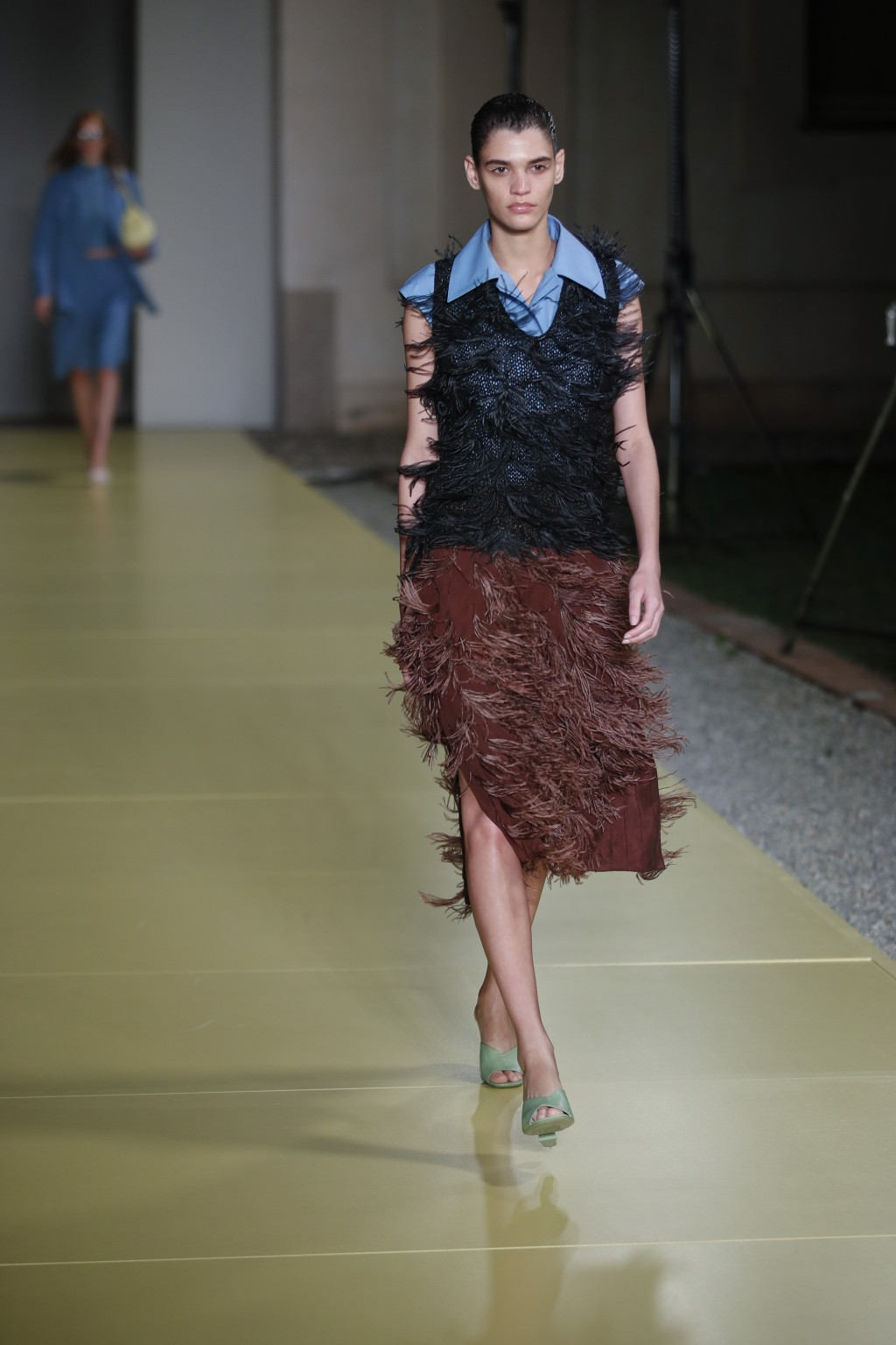A model wears a creation as part of the Salvatore Ferragamo 2021 women's spring-summer ready-to-wear collection during the fashion week in Milan, Ital...