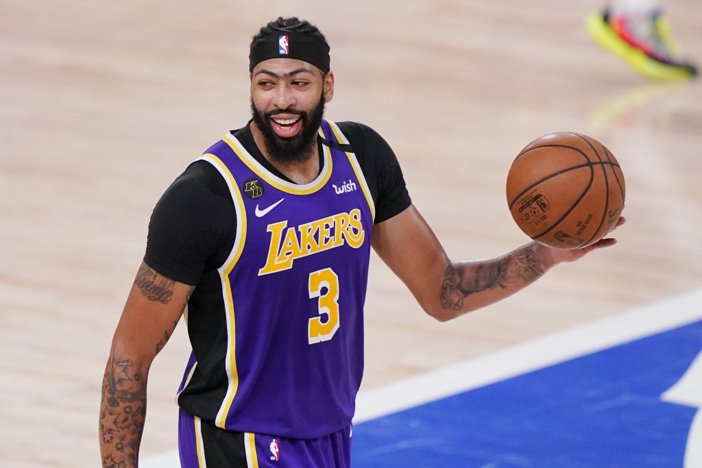 Los Angeles Lakers' Anthony Davis (3) celebrates after the Lakers beat the Denver Nuggets in an NBA conference final playoff basketball game Saturday,...