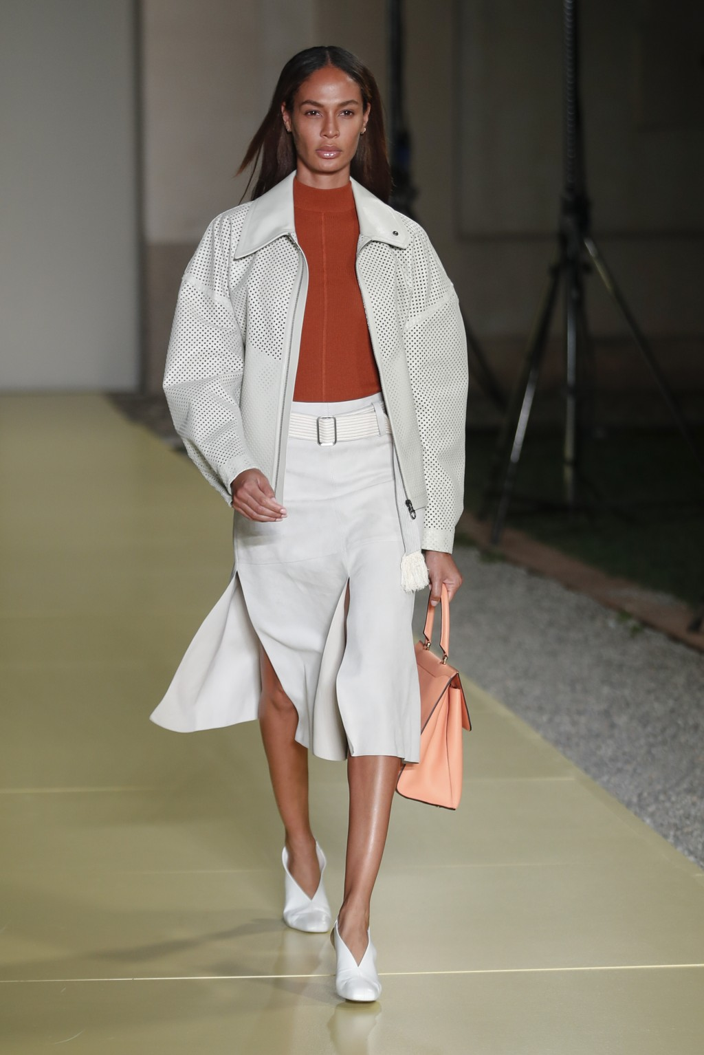 Model Joan Smalls wears a creation as part of the Salvatore Ferragamo 2021 women's spring-summer ready-to-wear collection during the fashion week in M...