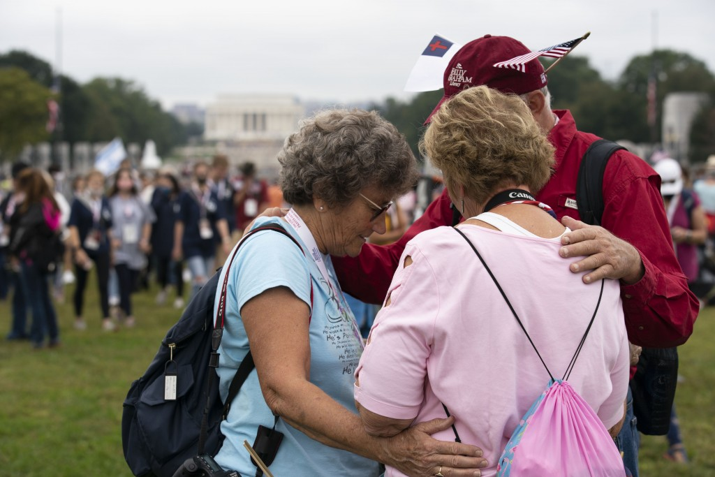 Followers of Franklin Graham stop to pray as they march from the Lincoln Memorial to Capitol Hill, during the Prayer March at the National Mall, in Wa...