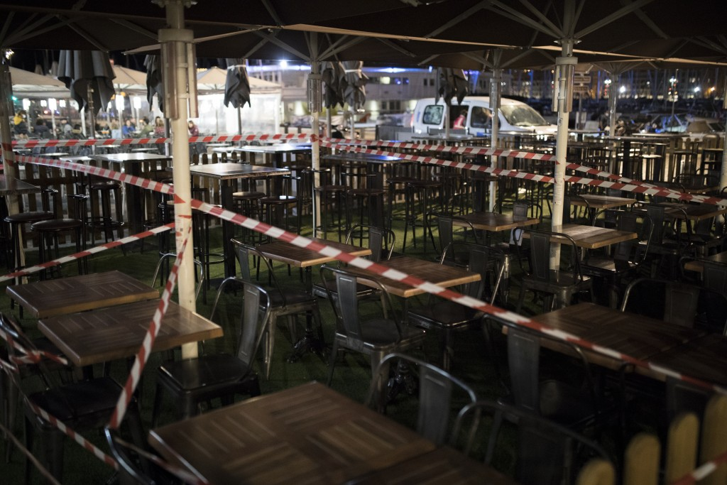 A bar terrace is cordoned off with tape in Marseille, southern France, Sunday Sept. 27, 2020. As restaurants and bars in Marseille prepared Sunday to ...
