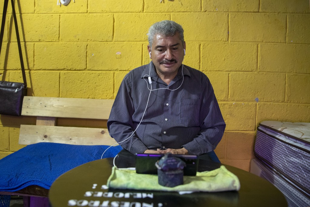 Fabio Rodolfo Vasquez is interviewed by a Mexican journalist online in his mother-in-law's home in the San Pedrito neighborhood of Guatemala City, Thu...