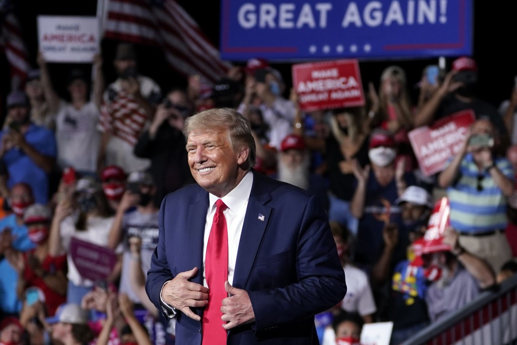 FILE - In this Sept. 8, 2020, file photo President Donald Trump stands on stage after speaking at a campaign rally at Smith Reynolds Airport in Winsto...