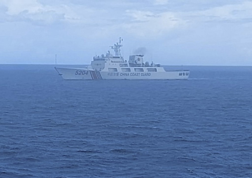 FILE - This undated file photo released on Tuesday, Sept. 15, 2020, by Indonesian Maritime Security Agency (BAKAMLA) shows a Chinese Cost Guard ship s...