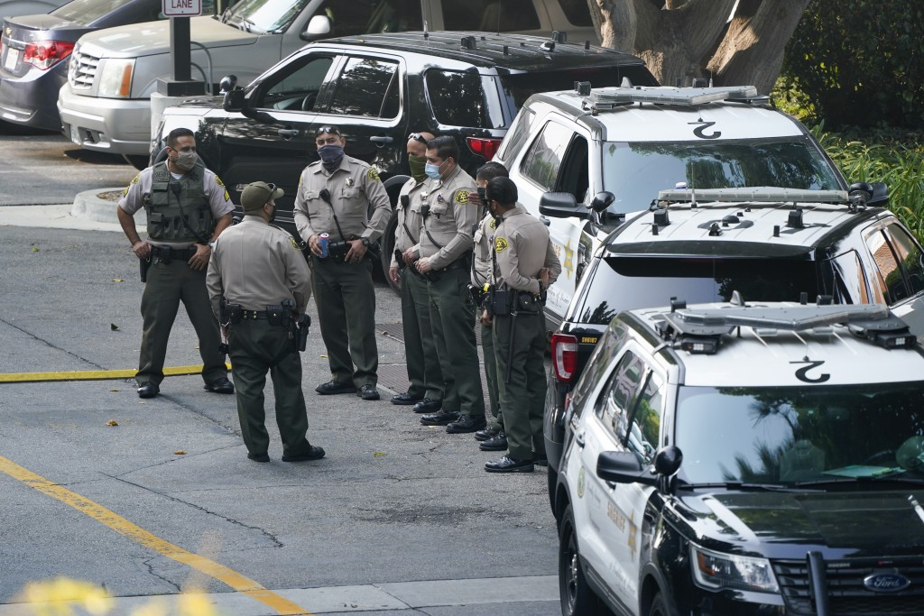 FILE - Police officers stand outside St. Francis Medical Center on Sept. 14, 2020, in Lynwood, Calif. after two Los Angeles County Sheriff's deputies ...