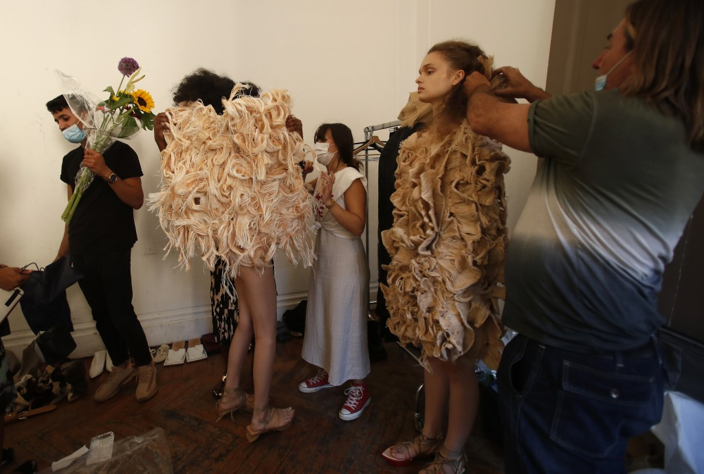 """Models wear creations part of the Claudia Gisele 2021 women's spring-summer collection at the """"We are Made in Italy - Black Lives Matter in Italian fa..."""