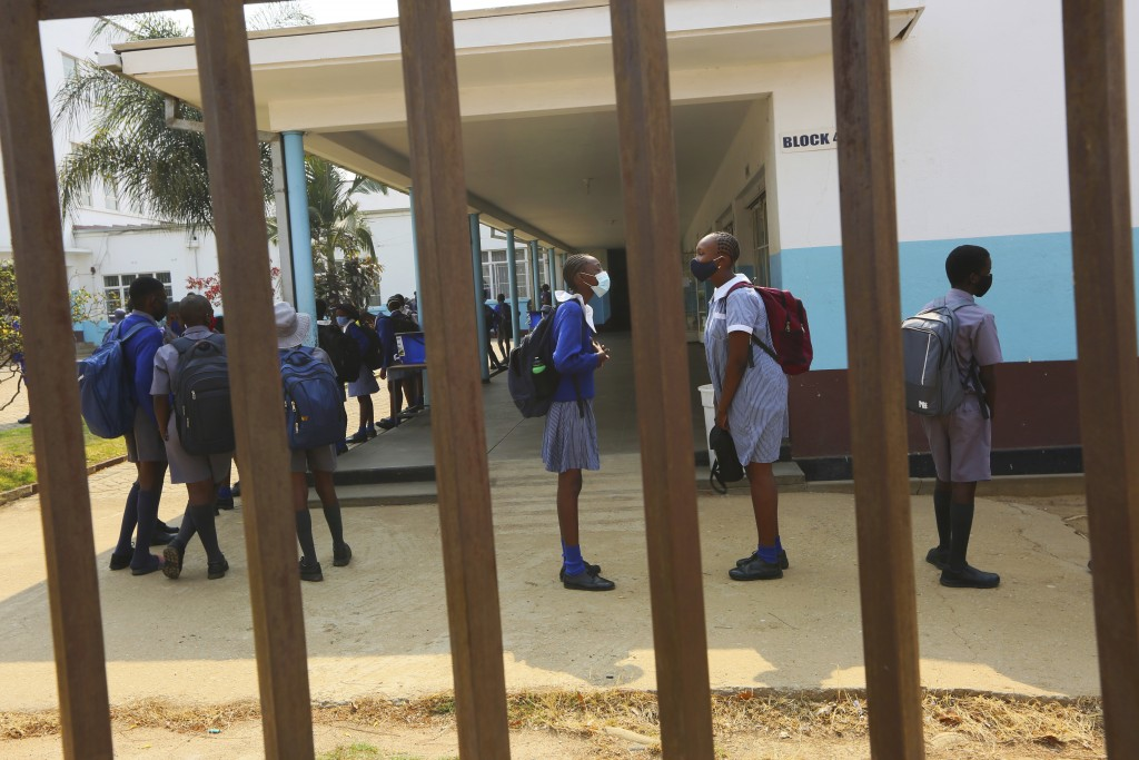 Schoolchildren inside their school in Harare, Zimbabwe, Monday, Sept, 28, 2020. Zimbabwe schools have reopened in phases, but with smaller number of p...
