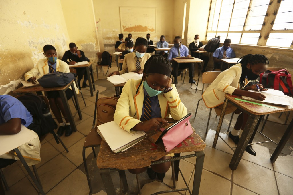 Pupils attend a class at a school in Harare, Monday, Sept, 28, 2020. Zimbabwe schools have reopened in phases, but with smaller number of pupils,more ...