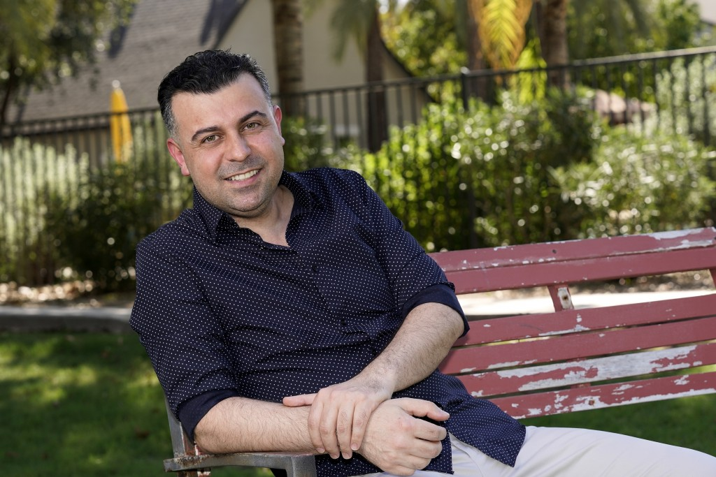 Iraqi born refugee Bilal Alobaidi and new U.S. citizen, poses for a photo Friday, Sept. 4, 2020, in Phoenix, Alobaidi, who arrived in the U.S. in Dece...