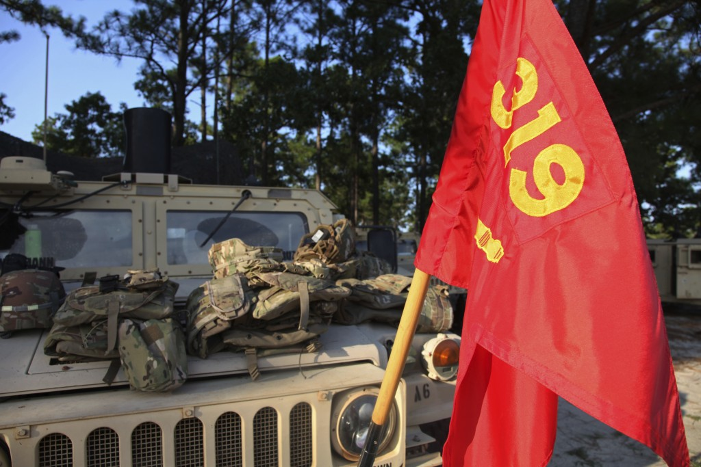 A flag representing the 82nd Airborne Division's 1-319th Field Artillery Regiment hangs from a Humvee in a remote location on Fort Bragg, N.C. on Wedn...