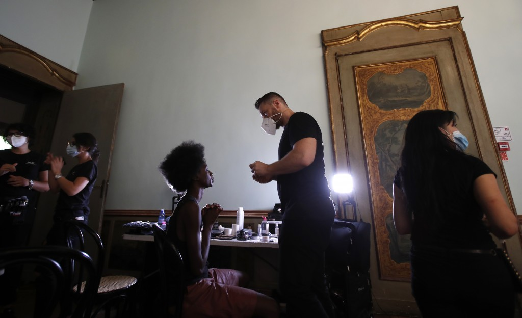 """A model gets her make-up done in the backstage at the """"We are Made in Italy - Black Lives Matter in Italian fashion Collection"""" event during the Milan..."""