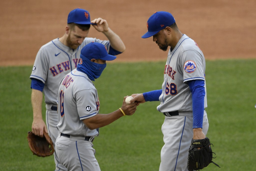 New York Mets relief pitcher Dellin Betances (68) is pulled by manager Luis Rojas, front left, during the sixth inning of a baseball game against the ...