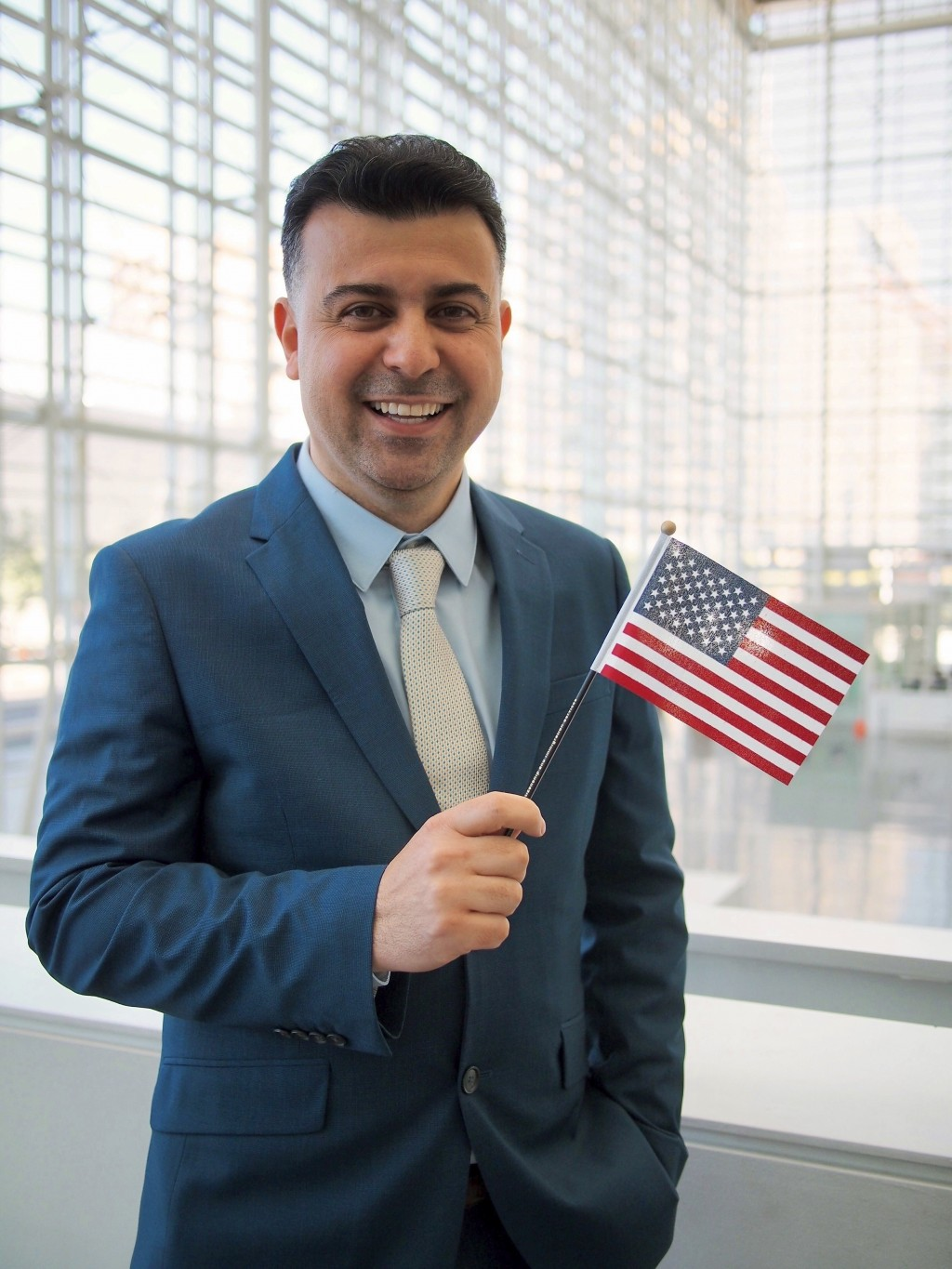 This September 2019 photo provided by Danielle Luna, shows Iraqi born refugee Bilal Alobaidi at his naturalization ceremony. Alobaidi, who arrived in ...