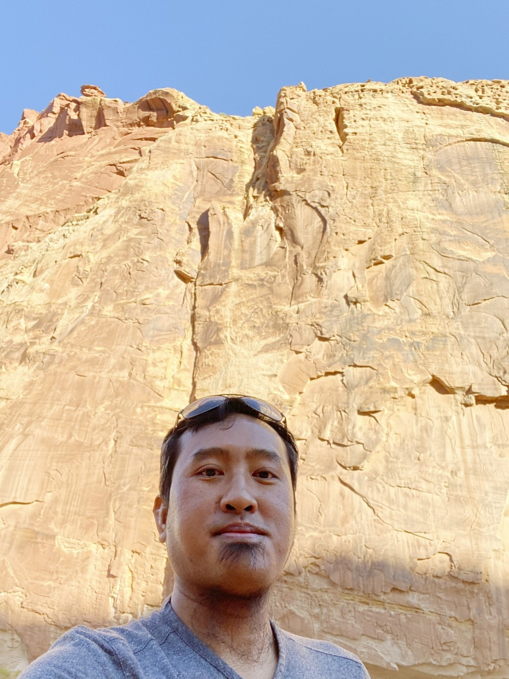 In this Aug. 15, 2020, photo provided by Lian Kual, resettled refugee Kual, originally from Myanmar, stands against a rock wall in the Capitol Reef Na...