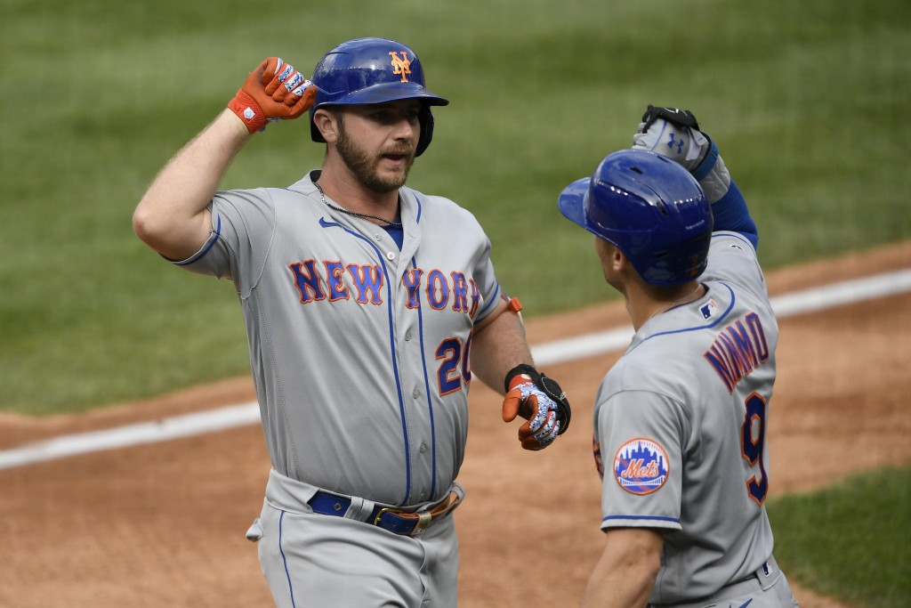 New York Mets' Pete Alonso, left, celebrates his two-run home run with Brandon Nimmo (9) during the first inning of a baseball game against the Washin...