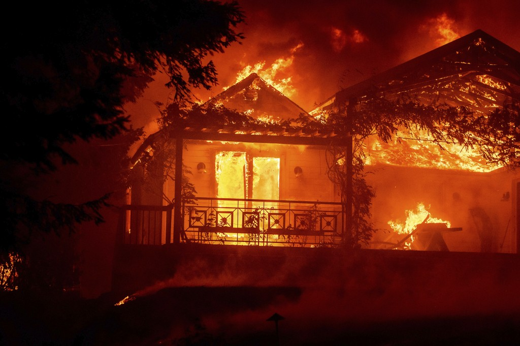 Flames from the Glass Fire consume the Glass Mountain Inn, late Sunday, Sept. 27, 2020, in St. Helena, Calif. (AP Photo/Noah Berger)