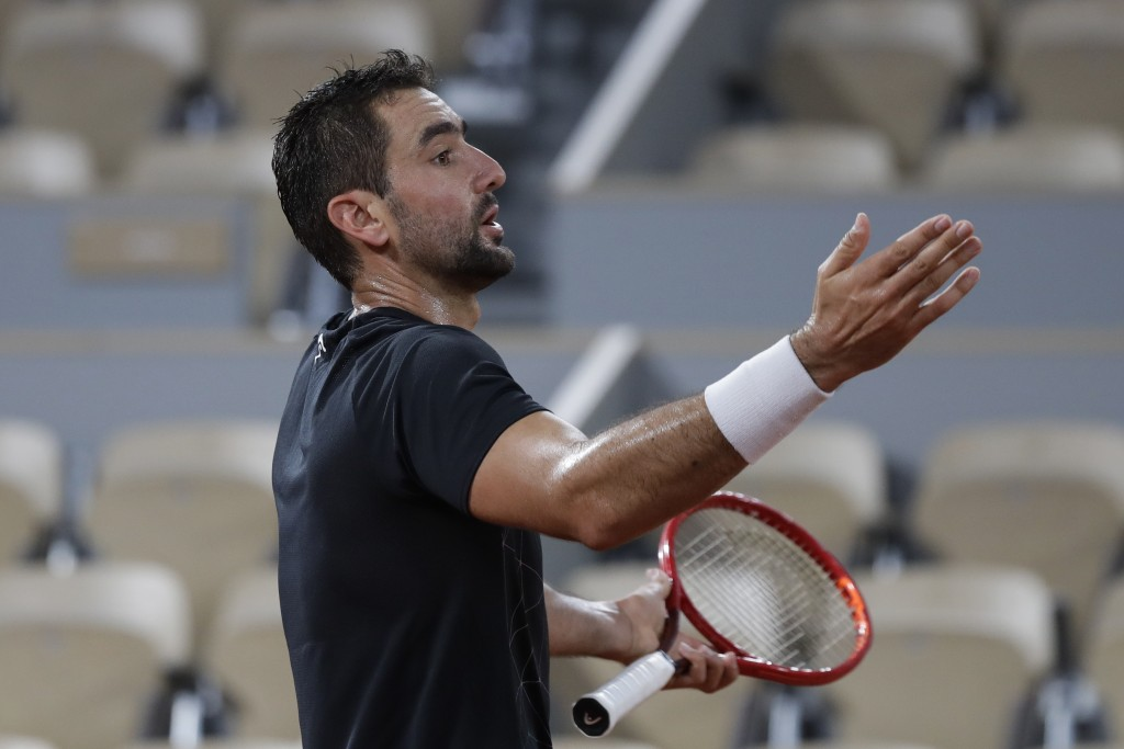 Croatia's Marin Cilic gestures in the first round match of the French Open tennis tournament against Austria's Dominic Thiem at the Roland Garros stad...