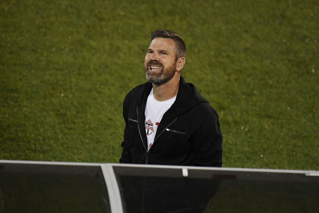 Toronto FC head coach Greg Vanney smiles during the first half of an MLS soccer match against Columbus Crew, Sunday, Sept. 27, 2020, in East Hartford,...