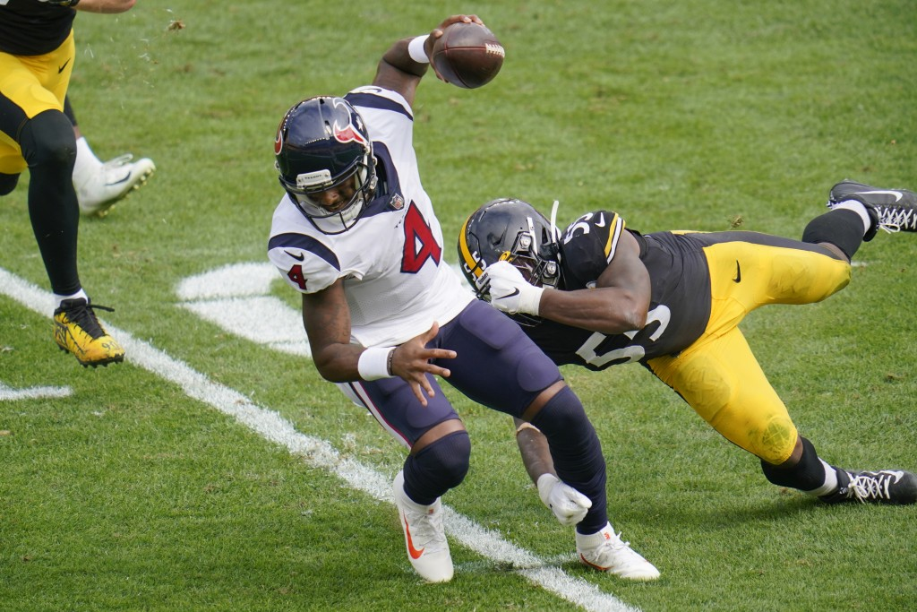 Houston Texans quarterback Deshaun Watson (4) tries to get past Pittsburgh Steelers inside linebacker Devin Bush (55) on a scramble during the first h...