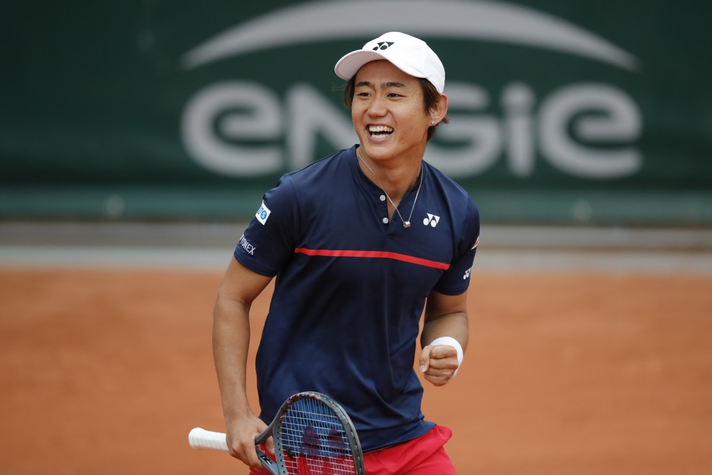 Japan's Yoshihito Nishioka celebrates winning his first round match of the French Open tennis tournament against Canada's Felix Auger-Aliassime at the...