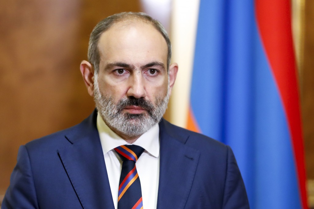 Armenian Prime Minister Nikol Pashinian pauses as he speaks at the Armenian parliament in Yerevan, Armenia, Sunday, Sept. 27, 2020. Pashinian on Sunda...