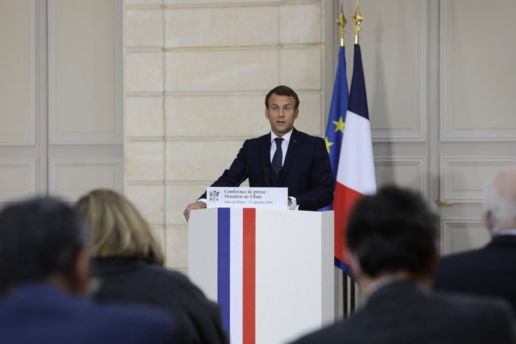 French President Emmanuel Macron speaks during a press conference on the situation in Lebanon, Sunday, Sept.27, 2020 in Paris. Lebanon's prime ministe...