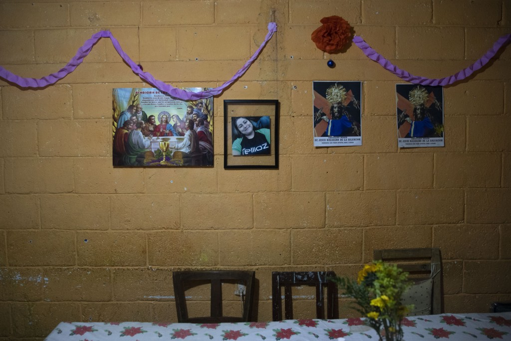 A framed portrait of Jenifer Vasquez hangs on a dining room wall in her grandmother's home, in Guatemala City, Thursday, Sept. 17, 2020. Vasquez was 3...