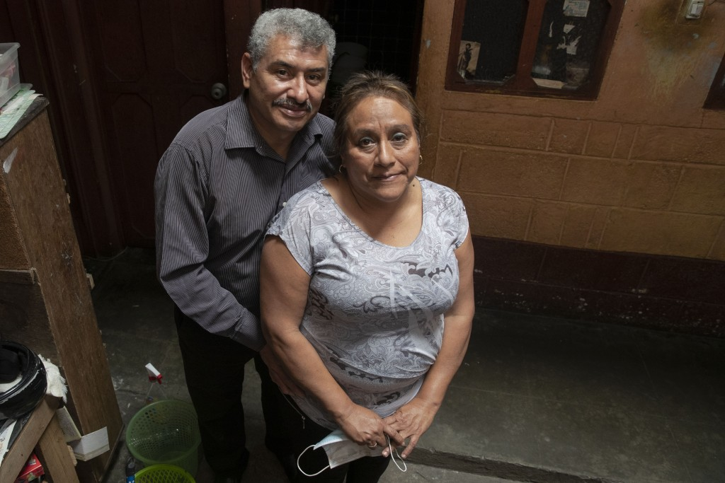 Fabio Rodolfo Vasquez and his wife, Maria Moreno, pose for photo in the home of Moreno's mother, in the San Pedrito neighborhood of Guatemala City, Th...