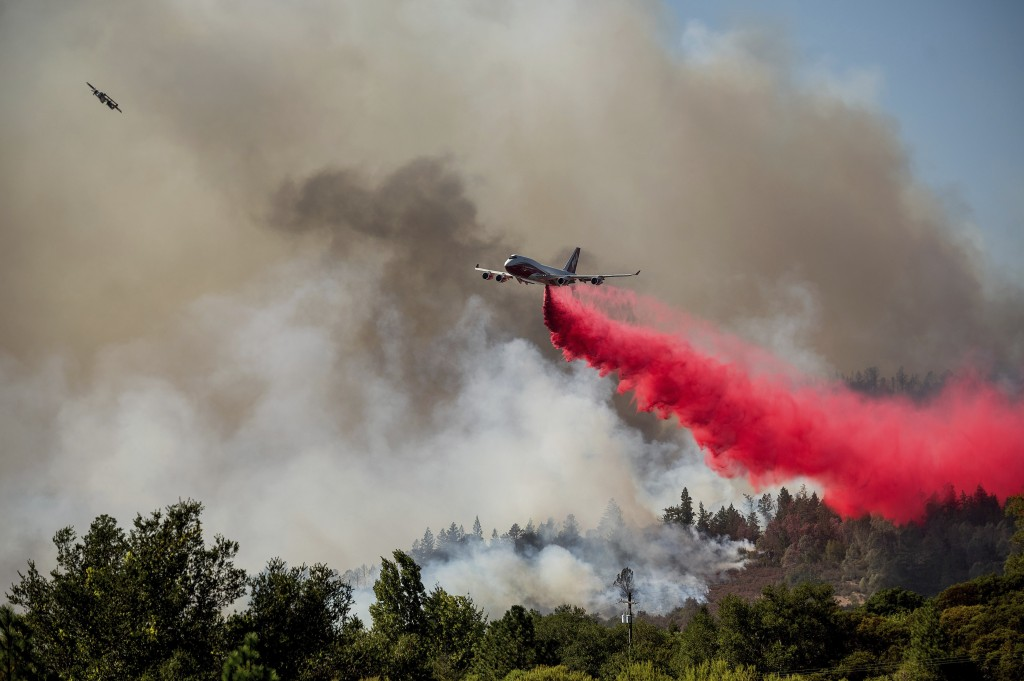 The Global Supertanker drops retardant while battling the Glass Fire in Napa County, Calif., on Sunday, Sept. 27, 2020. (AP Photo/Noah Berger)