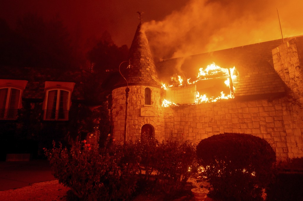 Flames from the Glass Fire consume Chateau Boswell Winery in St. Helena, Calif., Sunday, Sept. 27, 2020. (AP Photo/Noah Berger)