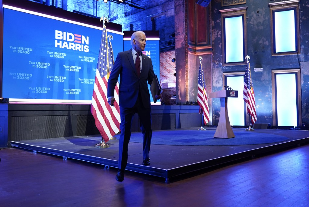 Democratic presidential candidate former Vice President Joe Biden walks off stage after giving a speech on the Supreme Court at The Queen Theater, Sun...