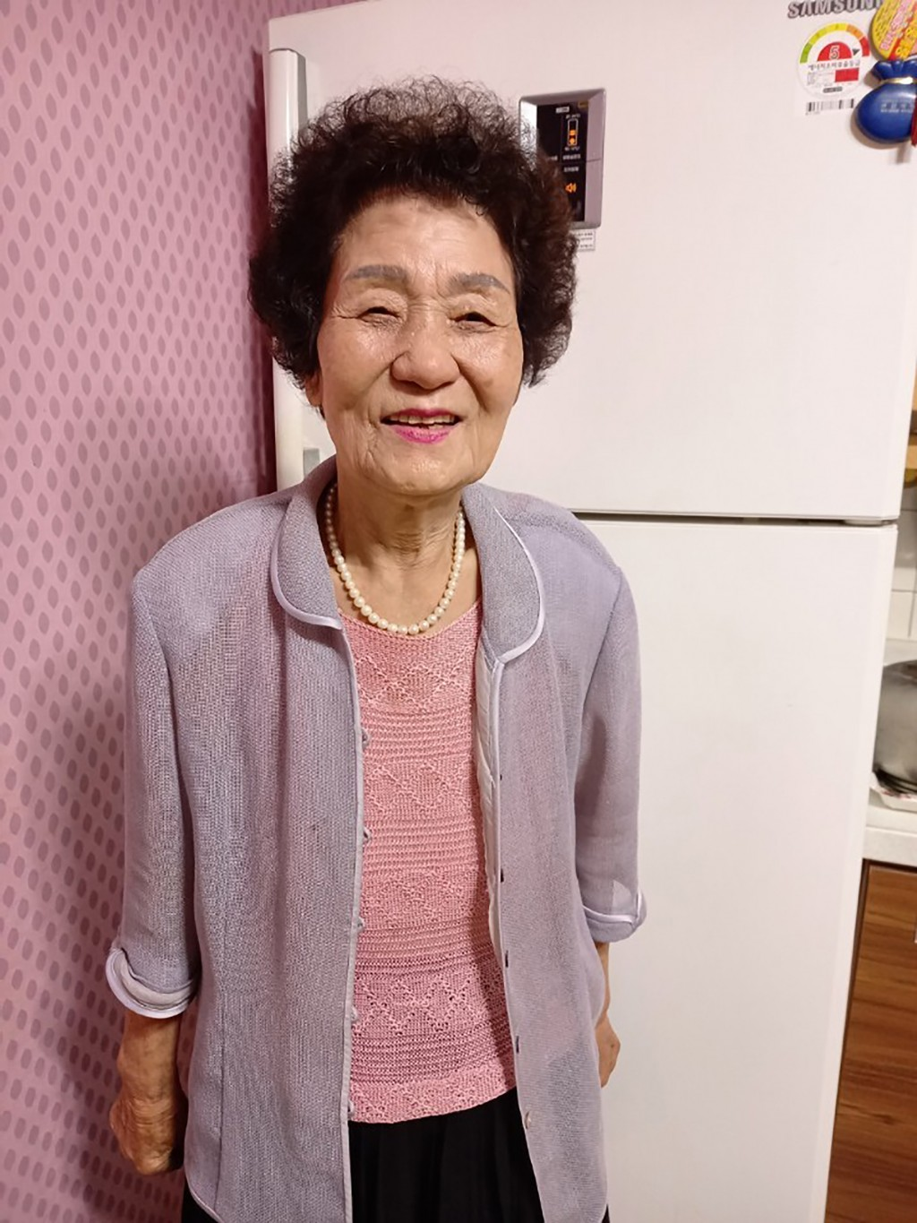 In this photo provided by Kang Myoung Suk, Chung Seong-ran, 84, poses for a photo at her home in Uiseong, South Korea, Wednesday, Sept. 16, 2020. The ...