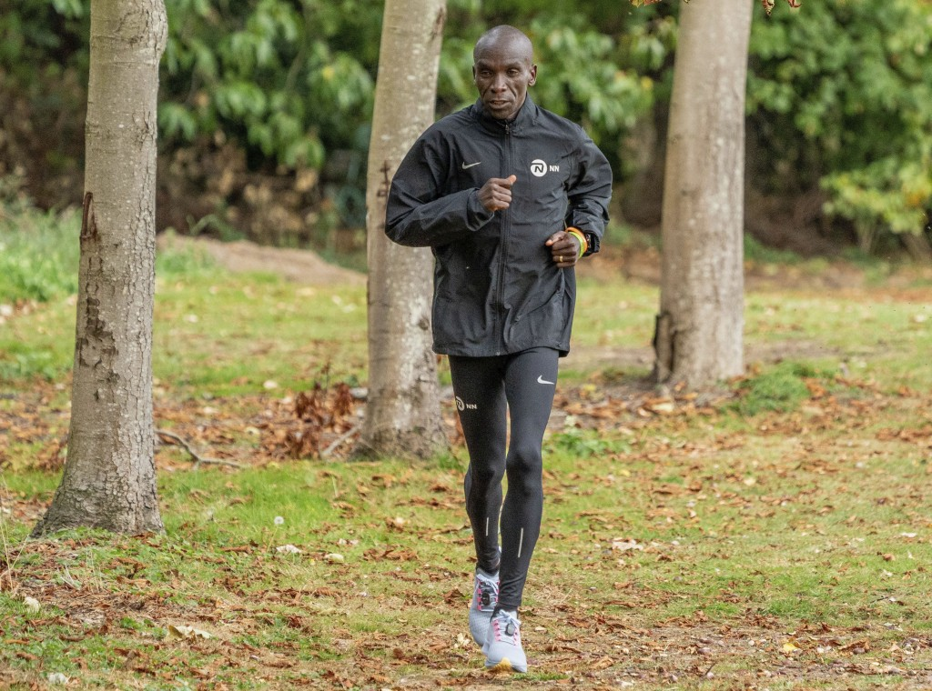 In this image issued by London Marathon Events, Kenya's Eliud Kipchoge trains in the grounds of the official hotel and biosecure bubble in London, Mon...