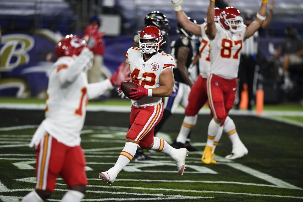 Kansas City Chiefs running back Anthony Sherman (42) and teammates celebrate his touchdown after his pass reception during the first half of an NFL fo...