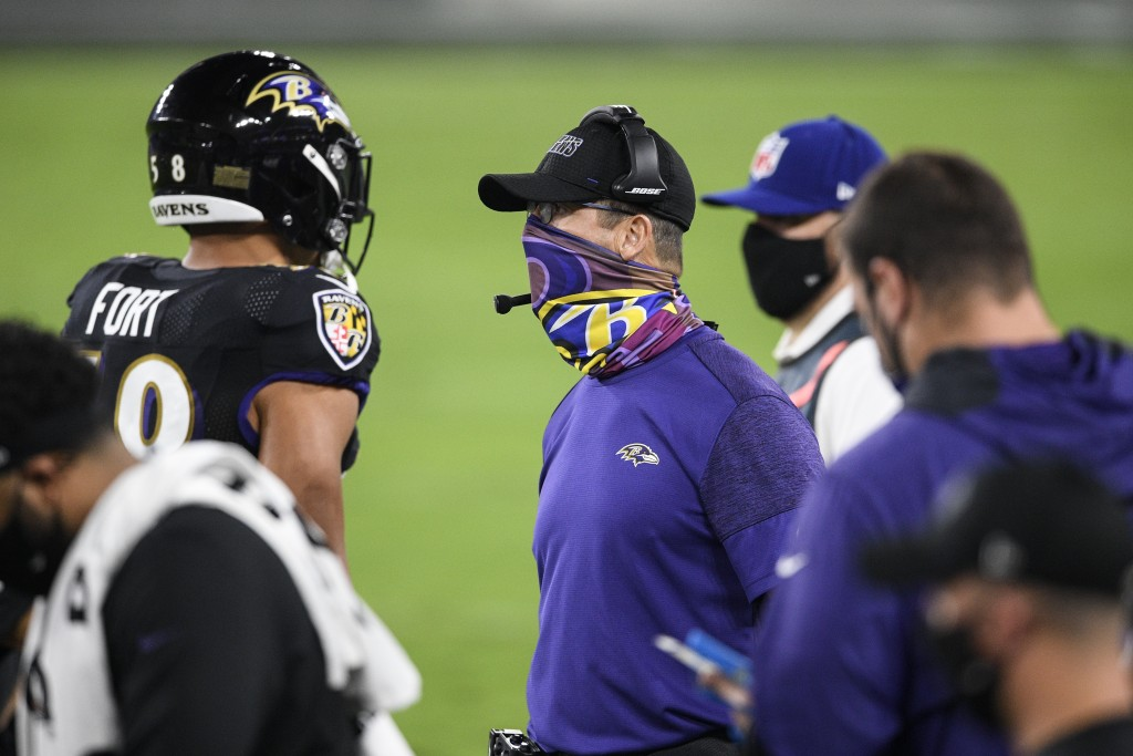 Baltimore Ravens head coach John Harbaugh watches his team during the first half of an NFL football game against the Kansas City Chiefs, Monday, Sept....