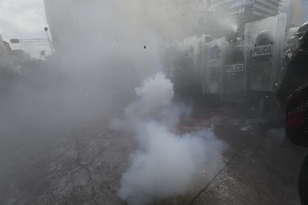Demonstrators clash with riot police during a march supporting abortion rights in Mexico City, Monday, Sept. 28, 2020. (AP Photo/Marco Ugarte)