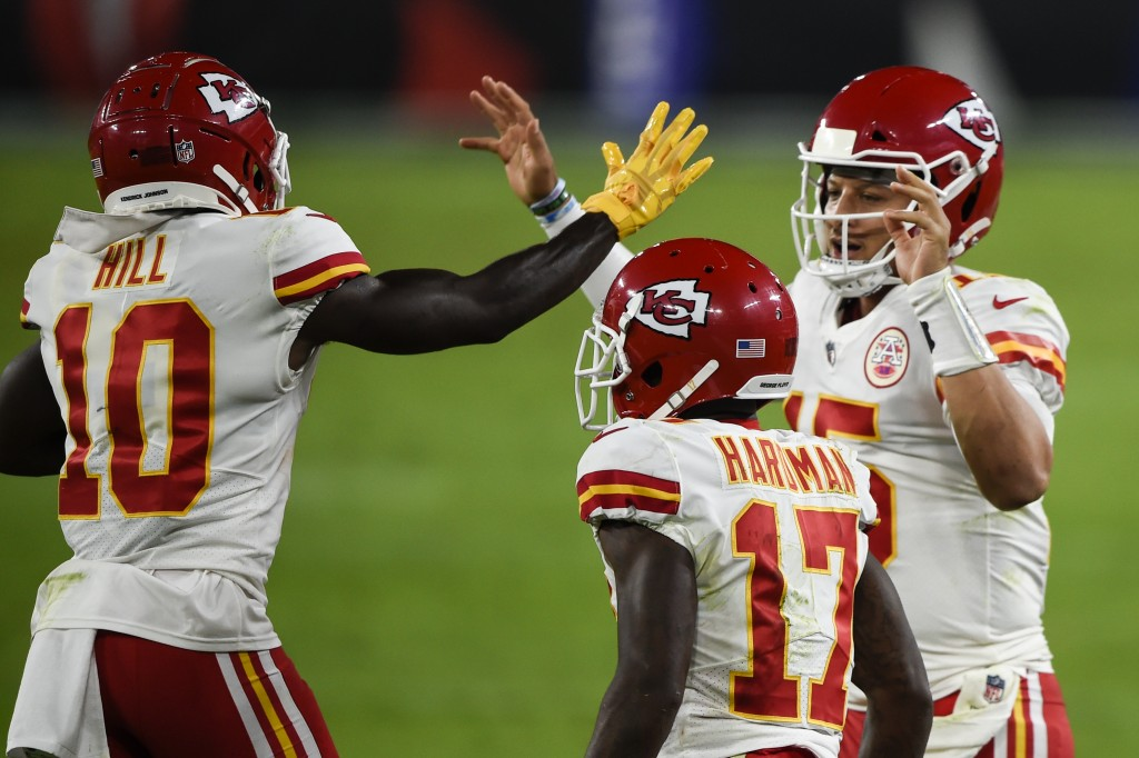 Kansas City Chiefs wide receiver Tyreek Hill (10) and quarterback Patrick Mahomes (15) celebrate after connecting for a touchdown with wide receiver M...