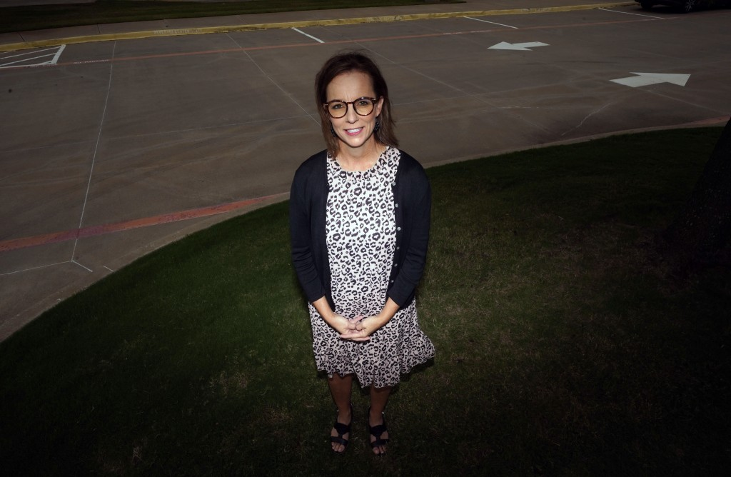 Shawna Jensen stands for a portrait in Mansfield, Texas, on Thursday, Sept. 24, 2020. Jensen's moment of reckoning came in March, as she sat in her su...