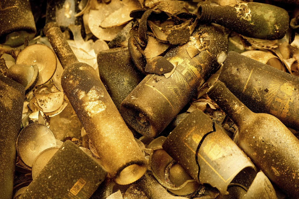 Charred wine bottles rest at Castello di Amorosa, Monday, Sept. 28, 2020, in Calistoga, Calif., which was damaged in the Glass Fire. (AP Photo/Noah Be...