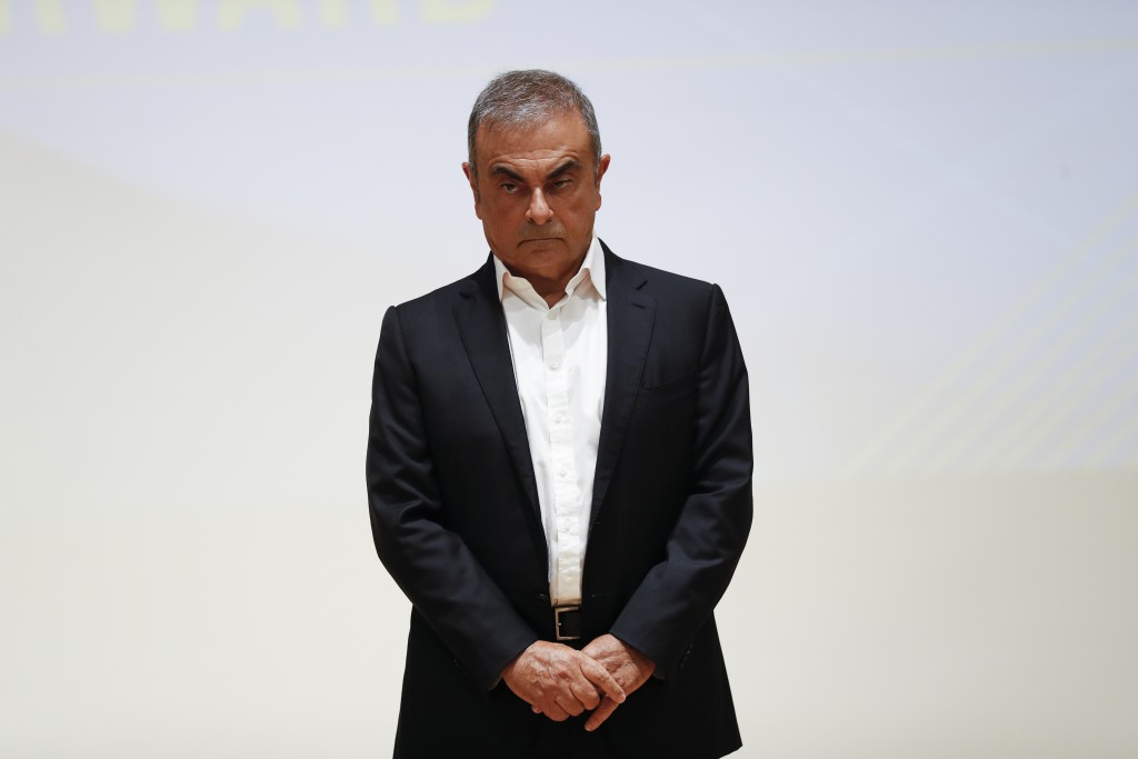 Nissan's former executive Carlos Ghosn stands during a press conference at the Holy Spirit University of Kaslik (USEK), north of Beirut, Lebanon, Tues...