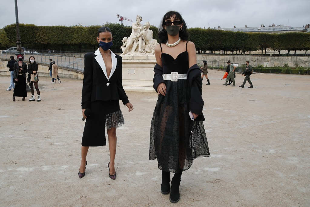 Fashion lovers strike a pose after Dior's Spring-Summer 2021 fashion collection presented Tuesday, Sept. 29, 2020 during the Paris fashion week. (AP P...