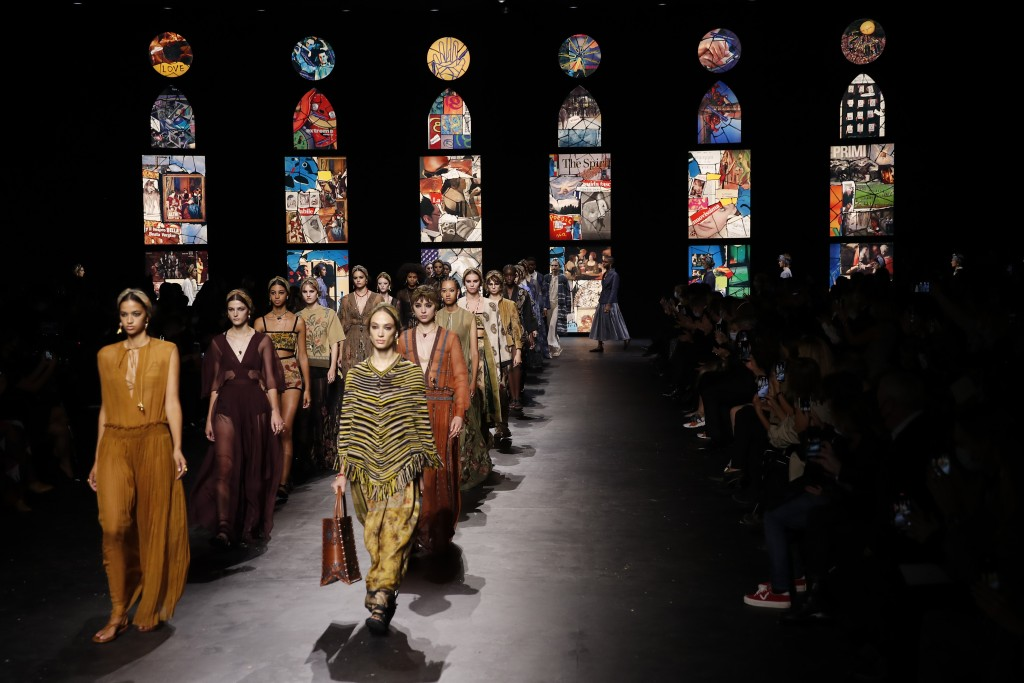 Models wear creations during Dior's Spring-Summer 2021 fashion collection presented Tuesday, Sept. 29, 2020 during the Paris fashion week. (AP Photo/F...