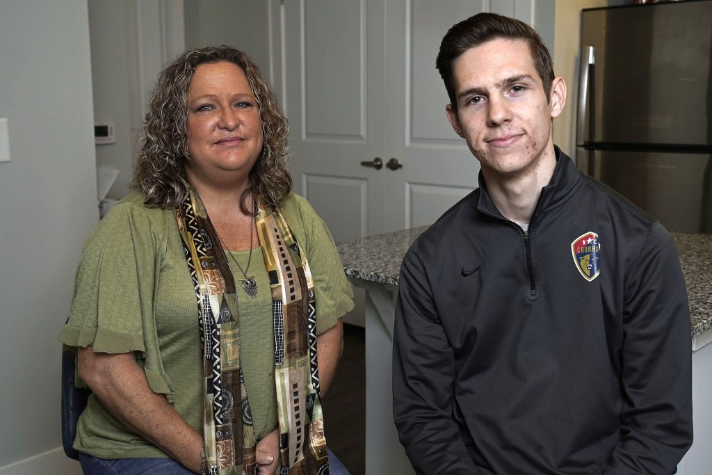 Zach Berly and his mother, Jennifer Wise, are photographed in his home in Fuquay-Varina, N.C., Friday, Sept. 25, 2020. They avoid talking about Donald...