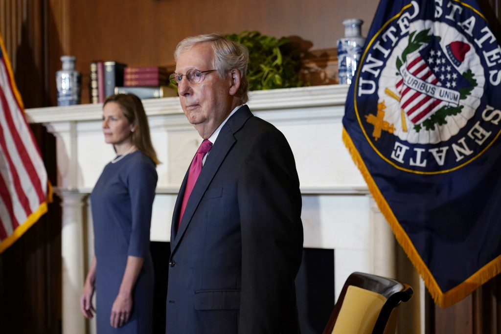 Senate Majority Leader Mitch McConnell of Ky., meets with Supreme Court nominee Judge Amy Coney Barrett on Capitol Hill in Washington, Tuesday, Sept. ...